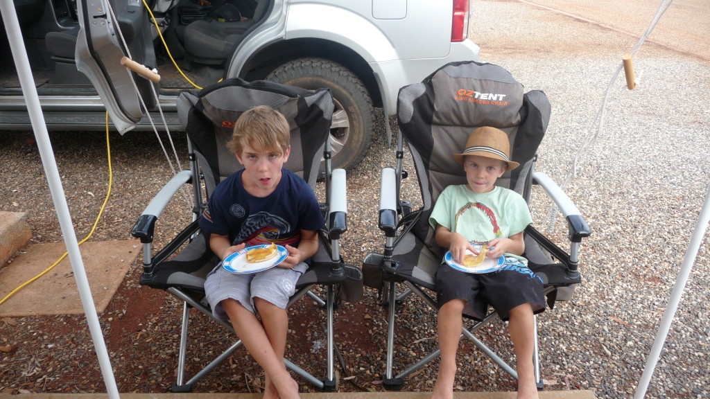 Lachy and Nathan having pancakes at Ayers Rock Campground