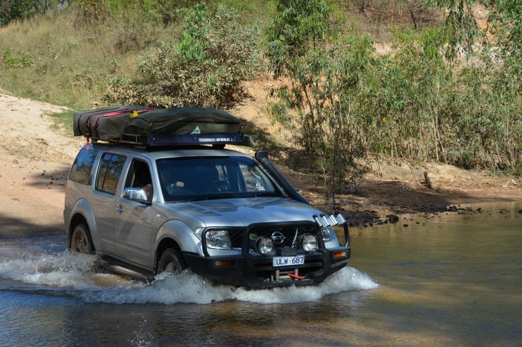 Michelle driving across the river Cape York